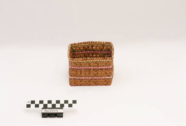 Square cedar basket, with a multicolored twine design around the basket, 2006